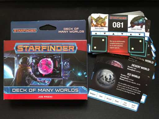 Starfinder Deck of Many Worlds, outside packaging and card examples.