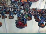 Alpha Legion Chaos Lord Alpharius, surrounded by his troops