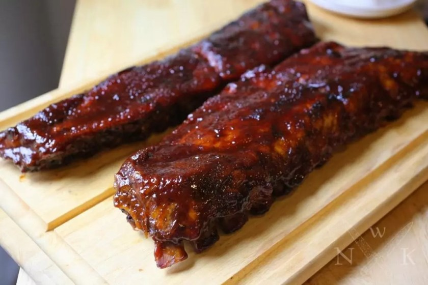 Glazed ribs on a board
