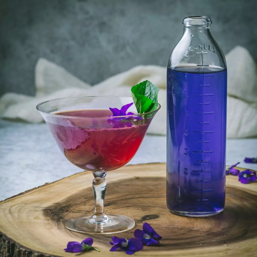 A violet syrup and a red cocktail