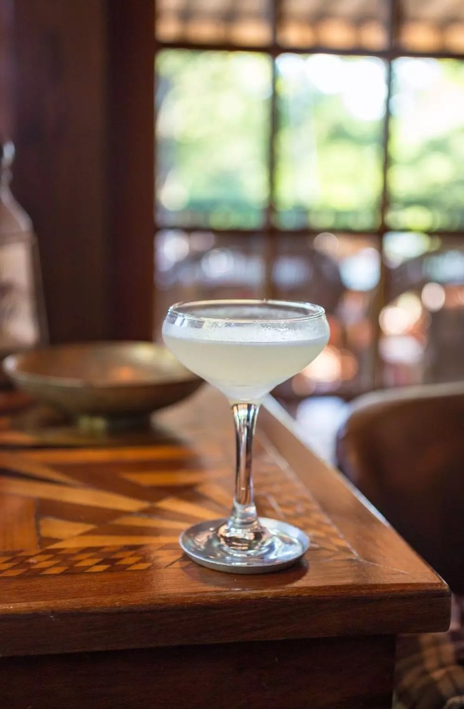 A pale cocktail in a coupe glass