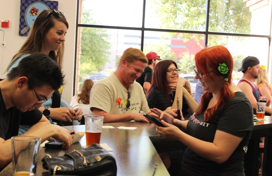 8-Bit Brewery co-owner Krystina Whitten chats with customers while closing tabs.