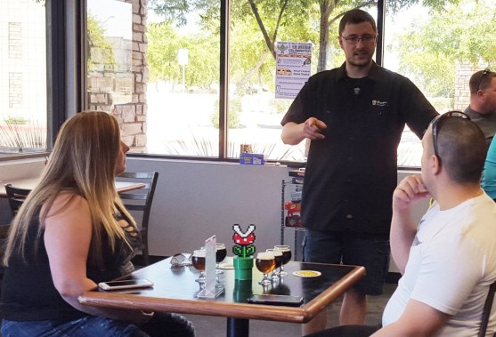8-Bit Aleworks co-owner Ryan Whitten chats with customers about beer flavors.