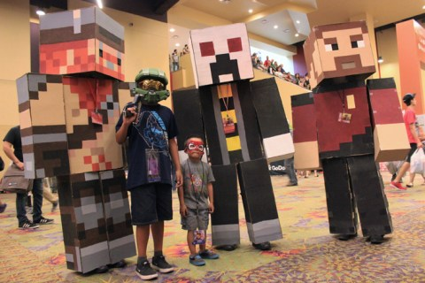 Three Minecraft characters pose with a mini Master Chief and Spiderman. [photo by Christen Bejar]