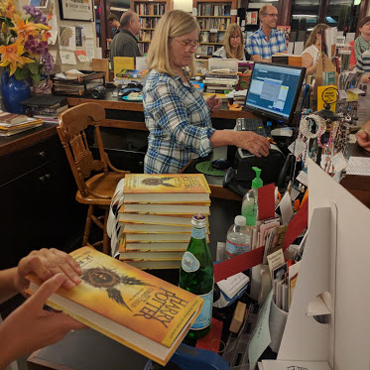 Cursed Child release party - SubText buying the book 4 square