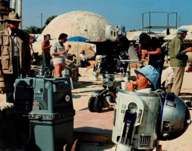 Kenny Baker eating a sandwich during a break from filming Star Wars as R2-D2