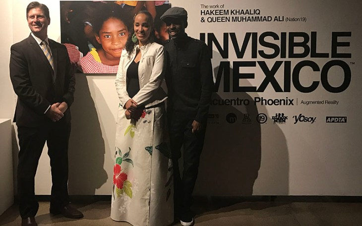 "Phoenix Mayor Greg Stanton (left) poses with ""Invisible Mexico"" artists Queen Muhammad Ali and Hakeem Khaaliq for the opening night of the exhibition on Thursday, March 2, 2017. (Photo by Ryan Santistevan/Cronkite News)"