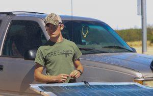 Morgan Smith, a senior at Palo Verde Magnet High School, prepares his solar-powered go-kart. (Photo by Erica Apodaca/Cronkite News)
