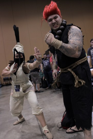 Ibuki and Akuma cosplayers from the Street Fighter series.