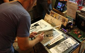 During the Halloween ComicFest in Glendale, customers flipped through comics created by local artists. (Photo by Maddy Ryan/Cronkite News)