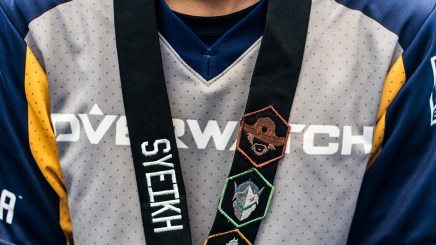 """The UC Berkeley team wore custom lanyards made by Kevin """"Slurpreethief"""" Royston's mother and featuring of their three favorite video game characters. (Photo by Daria Kadovik/Cronkite News)"""