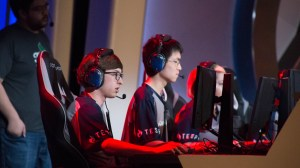 Benjy Duggan (left) and Cory Shen, members of the University of Arizona team, play Overwatch during an exhibition match against Arizona State University during the 2018 Fiesta Bowl Overwatch Collegiate National Championship. (Photo by Miles Metke/Cronkite News)