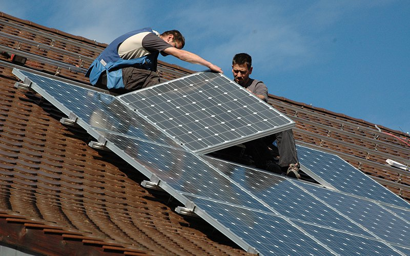 Solar installation work made up the biggest part of the more than 250,000 jobs in the solar industry in the U.S. in 2017, a slight drop in jobs from the year before, a new report says. (Photo by U.S. Army IMCOM/Creative Commons)