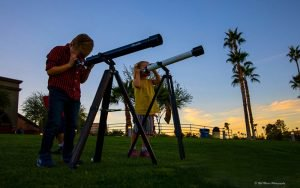 The Fountain Hills Astronomy Club and the Fountain Hills Library hold monthly star parties at which visitors can view the night sky through telescopes that have been donated to the library. (Photo courtesy of Rob Mains)