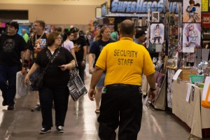 A security staff member patrols the exhibitor hall during Phoenix Comic Fest on Thursday. (Photo by Nick Serpa/Cronkite News)