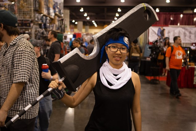 """Jiaqi Li, cosplaying as the character Zabuza from the anime """"Naruto,"""" said she didn't have any problem getting her large foam sword through security. (Photo by Nick Serpa/Cronkite News)"""