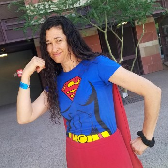 A Supergirl cosplayer flexes at Phoenix Comic Fest, Friday, May 25, 2018, at the Phoenix Convention Center.