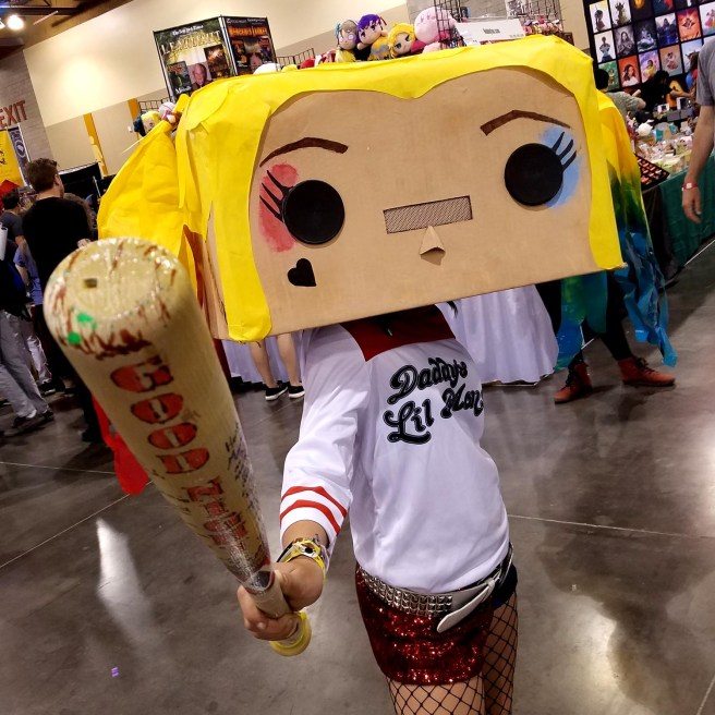 A Funko Pop-style Harley Quinn takes a swing at Phoenix Comic Fest, Saturday, May 26, 2018, at the Phoenix Convention Center.