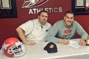 Former Mesa Community College offensive lineman Brandon Pertile (right) signed with Oklahoma State, thanks to the assistance of MCC coach Ryan Felker. (Photo from Brandon Pertile/Cronkite News)