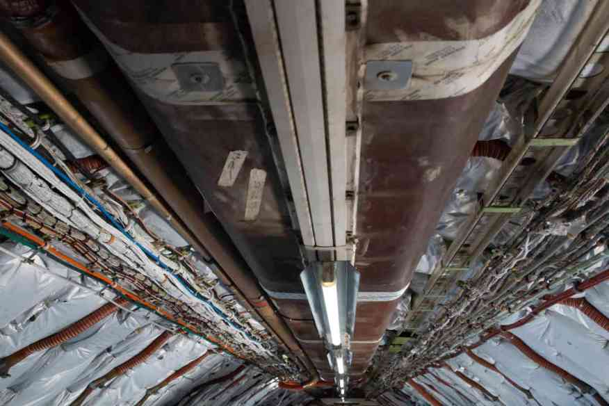 Honeywell stripped the interior of its Boeing 757 test plane, taking out overhead bins and exposing insulation, for easier access to components. (Photo by Nick Serpa/Cronkite News)