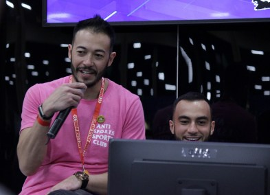 "Ryan ""Gootecks"" Gutierrez commentates at the Cygames Beast booth while team member Chris ""Chris T"" Tatarian plays."