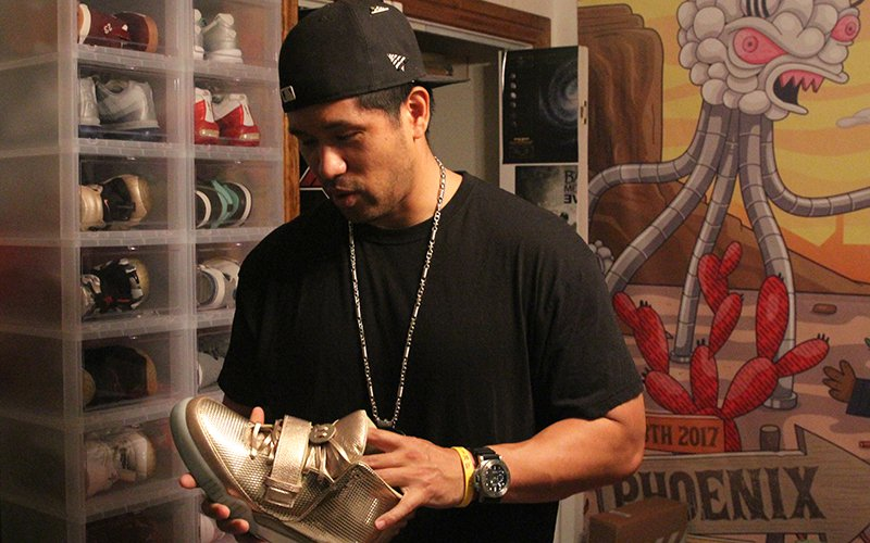 "J Carrillo, who goes by the alias ""Chilly,"" has only worn his Nike Air Yeezy 2 ""Golden Child"" shoes once. He said he'll wear them again, one his wedding day. (Photo by Nate Fain/Cronkite News)"