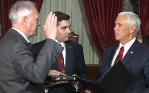 Vice President Mike Pence, right, administers the ceremonial oath of office to Arizona Sen. Jon Kyl, whose grandson Christopher Gavin holds the Bible in the Old Senate Chamber of the Capitol. (Photo by Imani Stephens/Cronkite News)