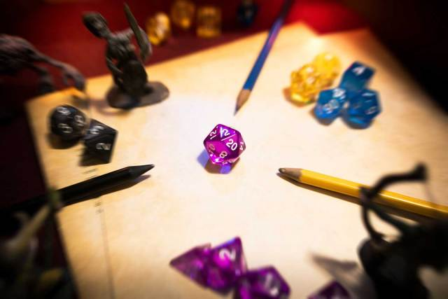 tabletop rpg dungeons dragons dice polyhedral miniatures pencil paper