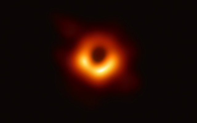 "The first-ever image of a black hole, an object in space that is so densely packed that not even light can escape its gravitational pull. University of Arizona researchers were on the global team of scientists that spent years to see ""the unseeable."" (Photo by Event Horizon Telescope/National Science Foundation)"