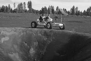 "Apollo 15 astronauts David Scott and James Irwin ride ""Grover,"" a lunar roving vehicle simulator during geology training at the Cinder Lake crater field in northern Arizona. (Photo courtesy of NASA)"