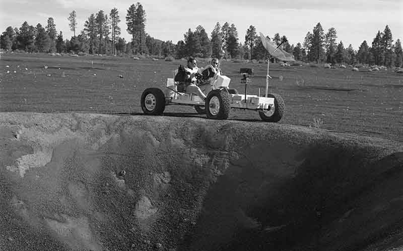 """Apollo 15 astronauts David Scott and James Irwin ride """"Grover,"""" a lunar roving vehicle simulator during geology training at the Cinder Lake crater field in northern Arizona. (Photo courtesy of NASA)"""