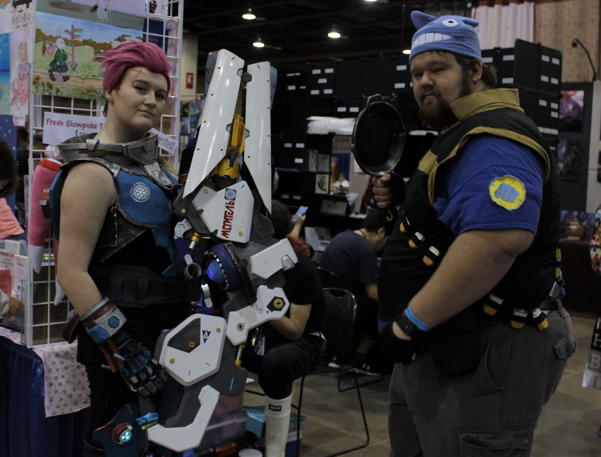 This Zarya (Overwatch) and Heavy (Team Fortress) cosplay pair showed off their weapons of choice. Photo by Justin Franco.
