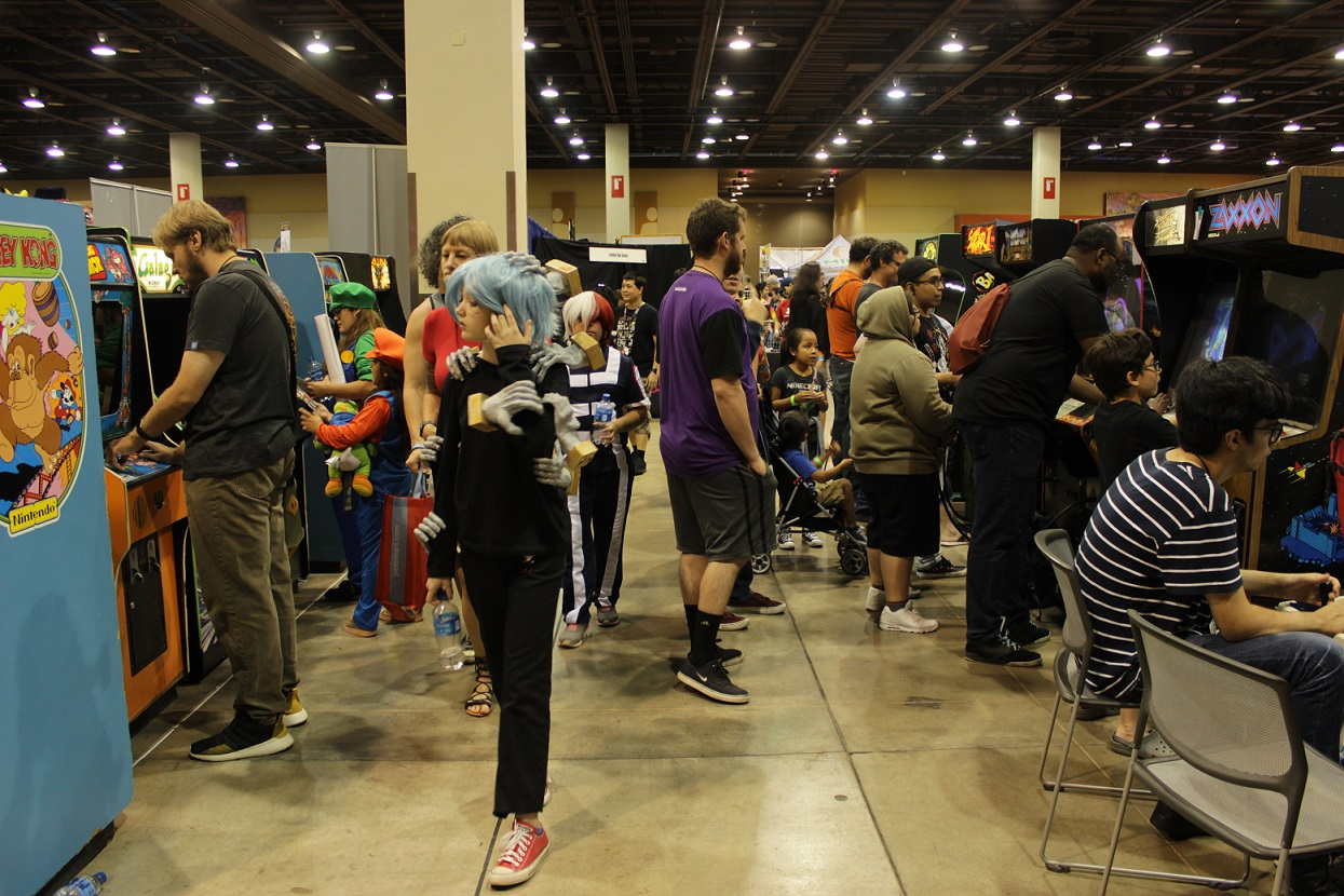 The aisle were filled with gamers playing a variety of titles on arcade machines. Photo by Justin Franco.