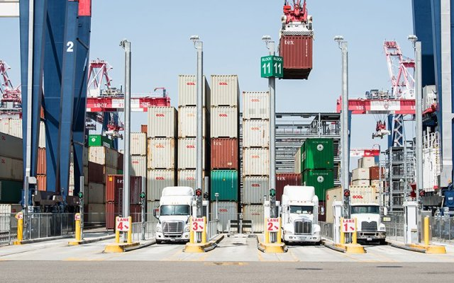 Trucks wait to be loaded with cargo at the port in Long Beach, Calif., in this 2017 photo. Arizona officials are concerned about the effect of new tariffs taking effect Sept. 1 on $300 billion in Chinese goods imported into the U.S. (Photo by Dennis Schroeder, NREL/Creative Commons)