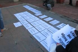 akcija lepljenja plakata