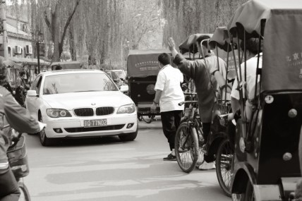 beijing rickshaw and bmw