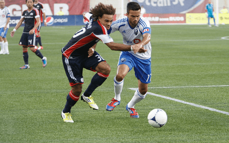 Revolution defender Kevin Alston (left) has been diagnosed with  chronic myelogenous leukemia, and will take an indefinite leave to undergo treatement. (Photo: Chris Aduama/aduama.com)