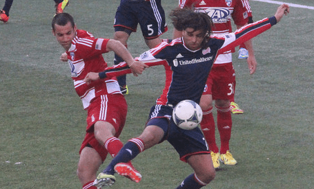 Juan Toja lunges for the ball with Andrew Jacobson nearby. (Photo: Kari Heistad/CapturedImages.biz)