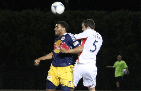 Revolution center back A.J. Soares goes toe-to-toe with Red Bulls forward Andre Akpan in Wednesday's Open Cup game. (Photo: Kari Heistad/capturedimages.biz)