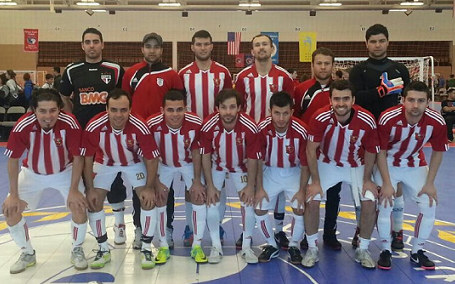 Junior (top row, third from left) regularly plays with Safira FC, a futsal team based in central Massachusetts.