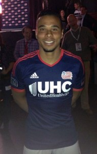 Charlie Davies poses in the new Revolution jersey at the team's jersey launch even at  Royale Boston on Tuesday. (Photo credit: Sean Donahue)