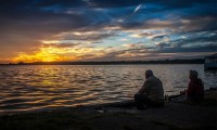 Grandparents sitting beside a lake - nessymon - source:pixabay