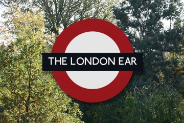 The London Ear roundel on a autumn leaf background
