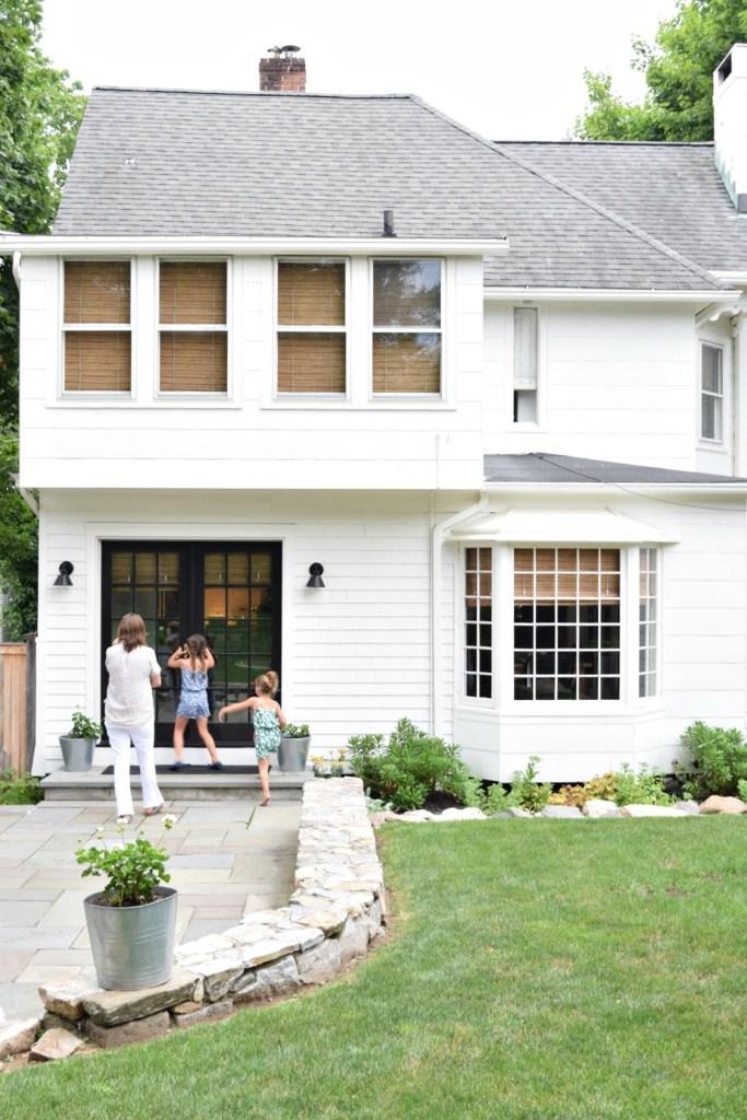 White home exterior backyard