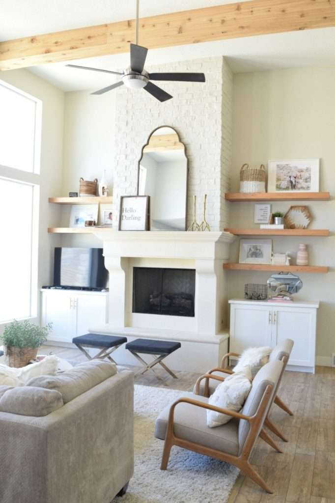 Great Room- White Kitchen- Brick Wall Painted White- Wood Beams- Light Wood Floors