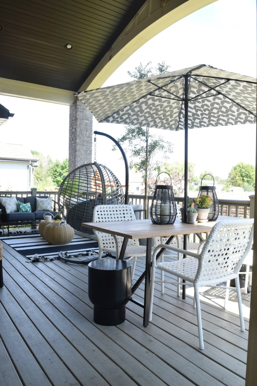 Outdoor Patio and Living Space with Hanging Chair ... on Backyard Outdoor Living Spaces id=46022