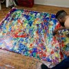 Los Angeles abstract artist Nestor Toro working on the painting in studio