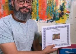 Artist Nestor Toro signing his work entitled Fearlessness
