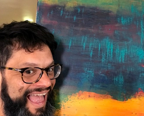Artist Nestor Toro is seen with his recently sold abstract artwork titled - Perhaps a Sunset