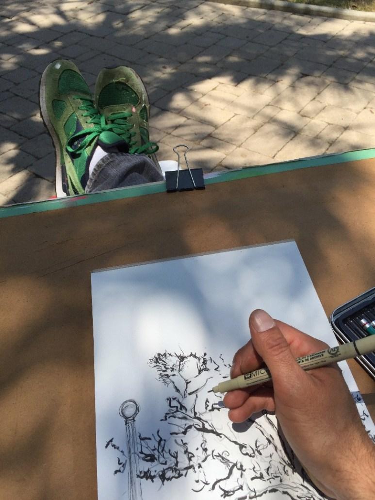 Nestor Toro sketching outside on a sunning day